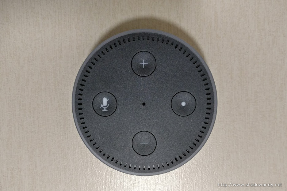 The volume control, microphone off and action button on the top face of the Amazon Echo Dot (2nd Generation)