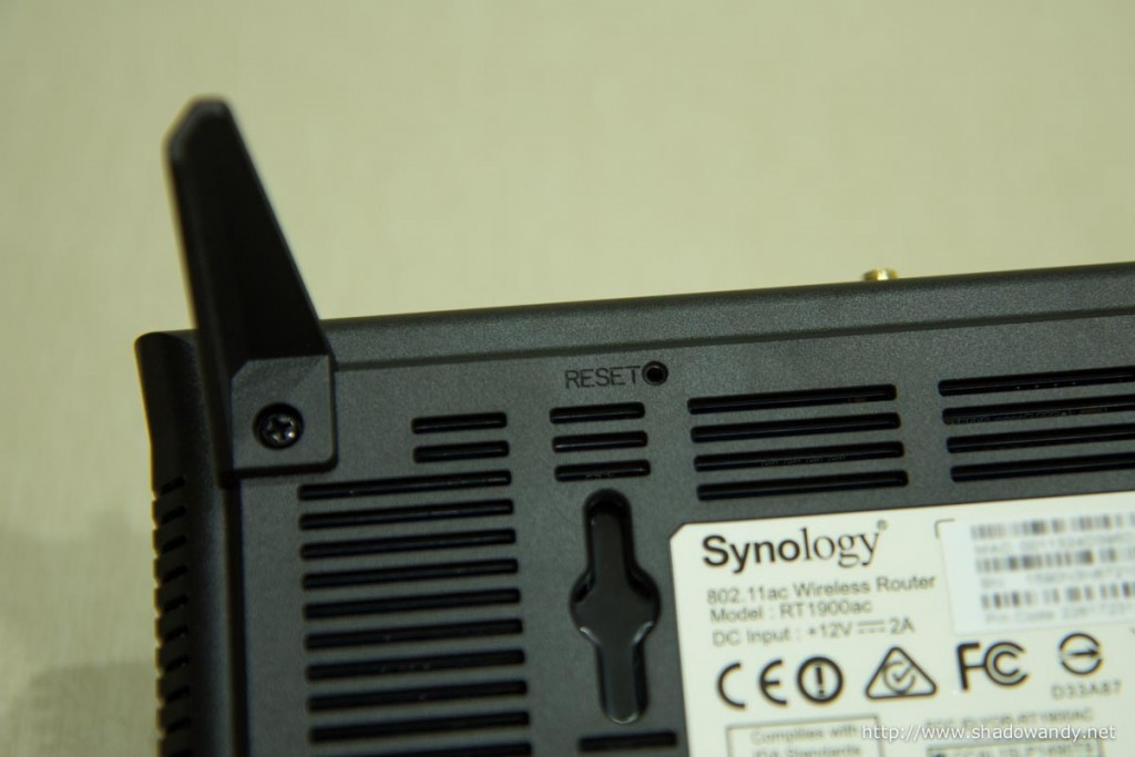 The reset button underneath the Synology RT1900ac.